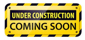 Warning sign in black and yellow reads 'Under Construction. Coming Soon'
